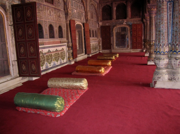 THE MAARAJAH WOULD SIT ON THESE CUSHIONS WITH HIS ADVISERS IN THE HALL OF AUDIENCES