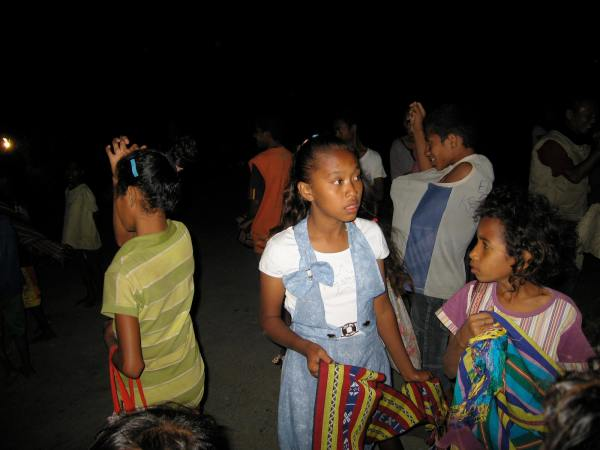 CHILDREN SELLING SHAWLS TO ORION PASSENGER SHIP TOURISTS