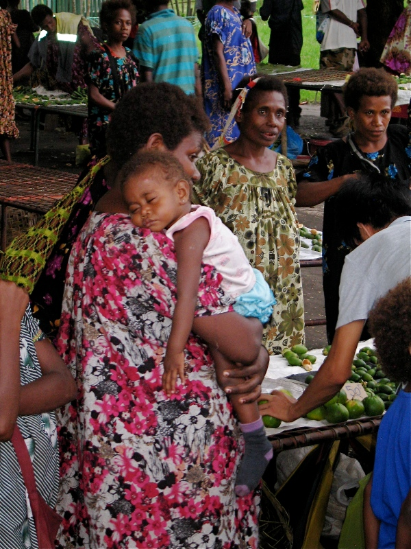WOMAN WITH HER BABY AT THE MARKET
