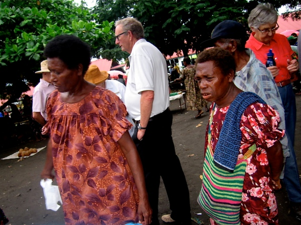 THE DRESSES THAT ARE WORN BY THE WOMEN ARE MADE IN PAPUA NEW GUINEA AND ARE POPULAR THROUGH OUT MELANESIA