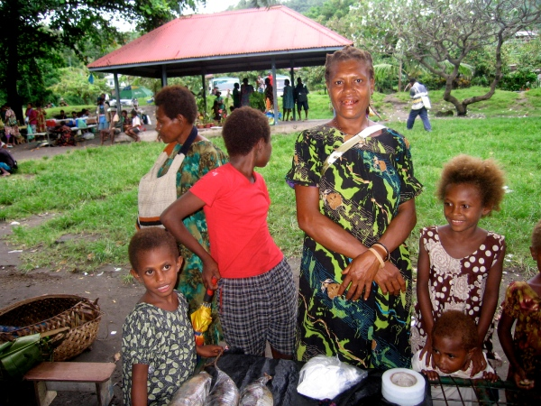 A MOTHER AND HER CHILDREN AT THE MARKET IN RABAUL