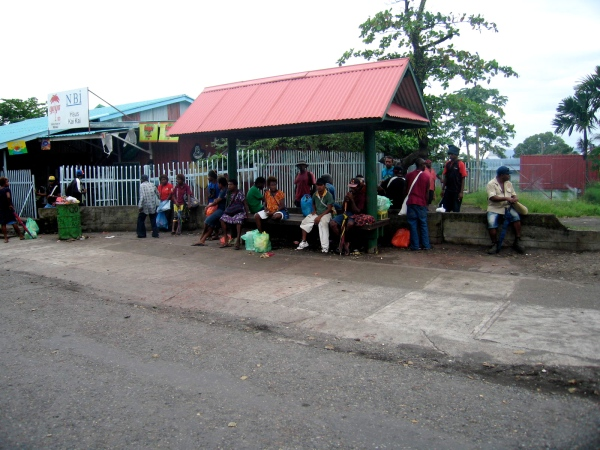 PEOPLE WAITING OUTSIDE THE MARKET