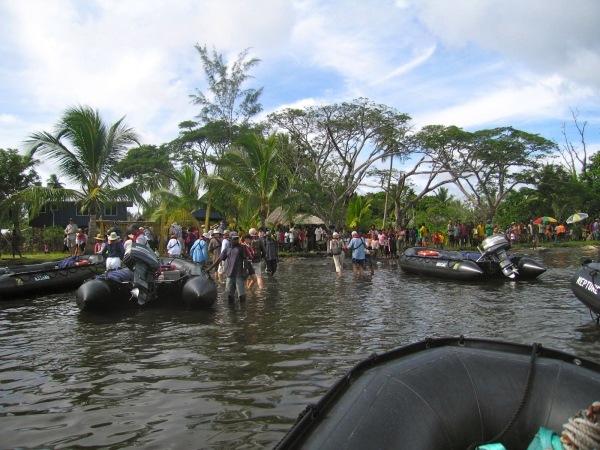 WE ARRIVE IN ZODIAC BOATS AND ARE WELCOMED BY THE VILLAGE