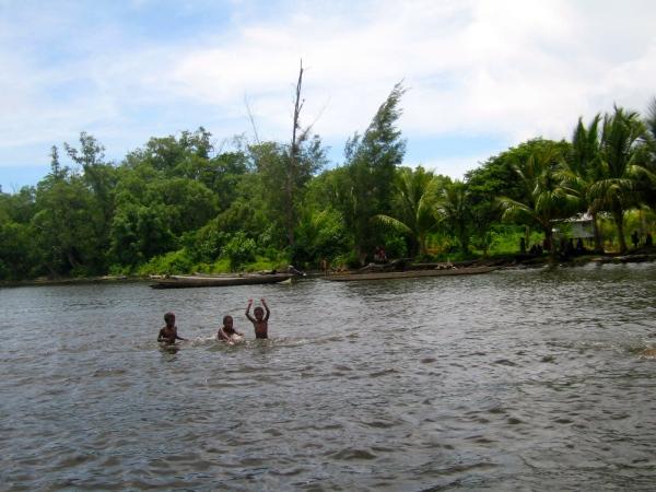 CHILDREN SWIMMING  IN THE SEPIK RIVER