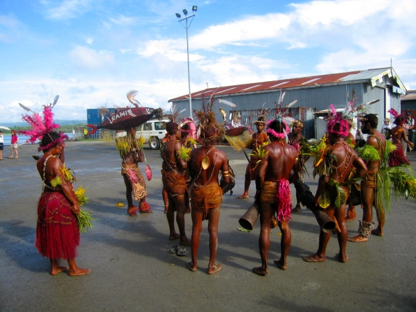 MALE DANCERS WITH DRUMS COVERED WITH LIZARD SKIN