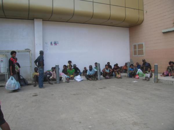 PEOPLE WAITING FOR TRANSPORTATION