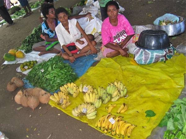 VENDOR SELLING BANANAS AND ORANGES