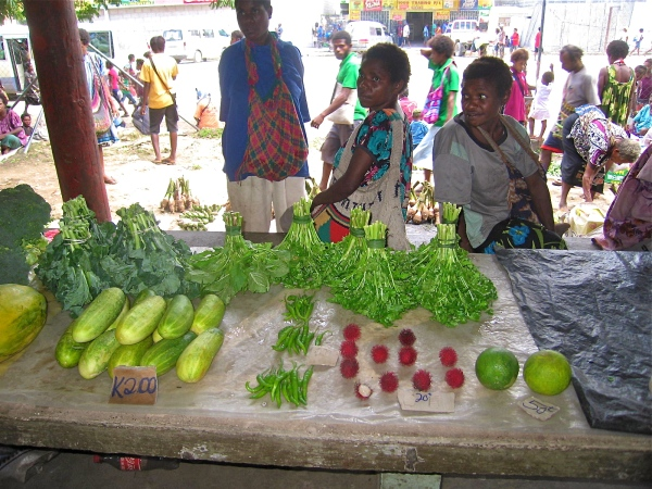VENDOR SELLING CUCUMBERS AND OTHER VEGETABLES