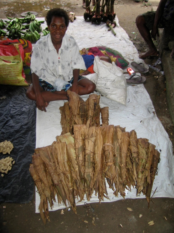 VENDOR WITH TAPIOCA WRAPPED IN BANANA LEAF