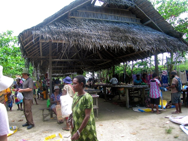MADANG MARKETS - In the center of Madang is a busy local market. People come daily from the PNG Highlands with produce to sell and load up with goods to take back with them at the end of the day. A wide variety of fruits and vegetables are available.