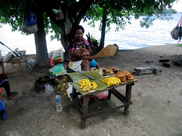 FOOD VENDOR WITH HER BABY