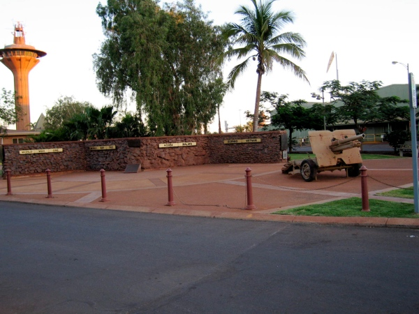 WAR MEMORIAL  -   The Wall of Rememberance featured here is located on the Esplanade at the entrance to the Port and opposite the Esplanade Hotel, built from 48 tonnes of iron ore donated by various Mining Companies. Building commenced with the laying of the foundation stone by Lt.Col. B.G.Wallis, Commanding Officer, The Pilbara Regiment on Anzac Day,1988 in memory of WX11020 Capt.Bert Madigan MC MID, 2/16th.Btn,AIF, the completed Wall, dedicated to the men and women of the Pilbara for their sacrifices in peace and war, was unveiled by W.O.1 Percy White DCM 18th.August,1991. At the l/h end is mounted a plaque that records that the wall was designed by P.Blenkinsop and bears the names of those who worked on the construction. On the right, in front of the wall, is a 25pdr. field gun.