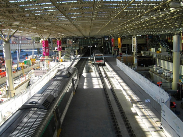 TRAINS AWAITING DEPARTURE AT A PERTH STATION - PERTH METRO RAIL PROJECT IS MODERNING THE METRO SYSTEM IN PERTH