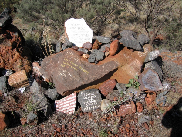 A rock pile memorial on top of a hill near Tom Price. The writings on the rocks honour those people who have died in the nearby mines..