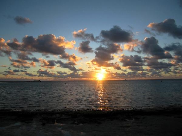 SETTING SUN CORAL BAY
