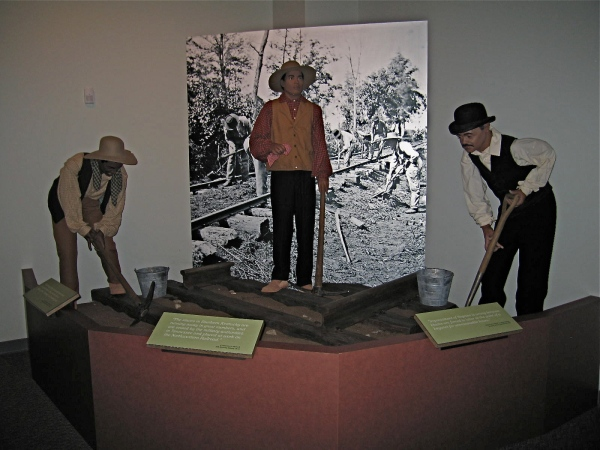 TABLEAU SHOWING FORMER SLAVES BEING PUT TO WORK ON THE RAILROAD BY THE MILITARY AUTHORITIES