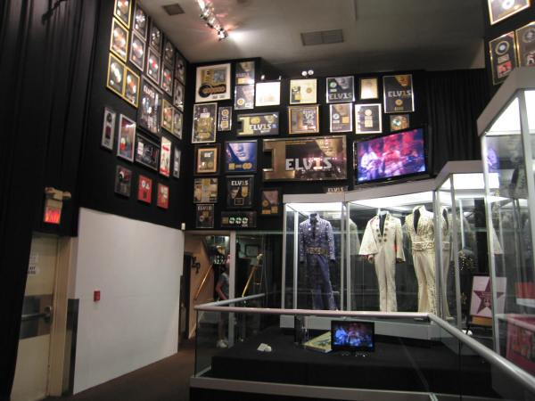 ELVIS HAD MANY COSTUMES AND GOLD RECORDS