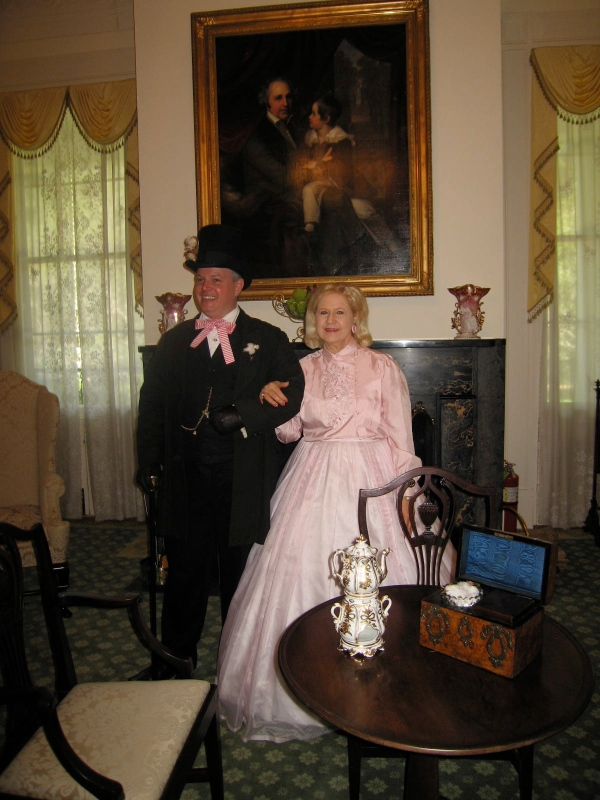 BRANDON HALL -  GUIDES IN PERIOD COSTUMES IN THE SITTING ROOM