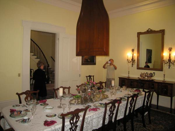 BRANDON HALL  -  DINING ROOM ACE THE TABLE IS A PUKAH . (Pukah  - The pukah, coming to Natchez by way of the West Indies, is a large fan, often of wood, hanging over the dining room table for shooing away insects and for cooling purposes).