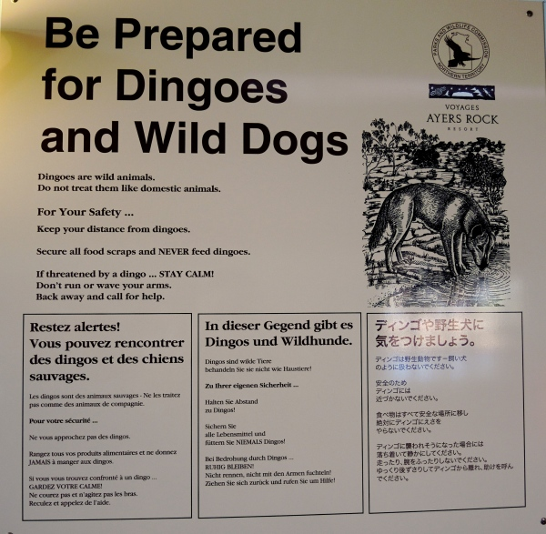 A SIGN AT THE AIRPORT WARNS OF DANGEROUS DINGOES