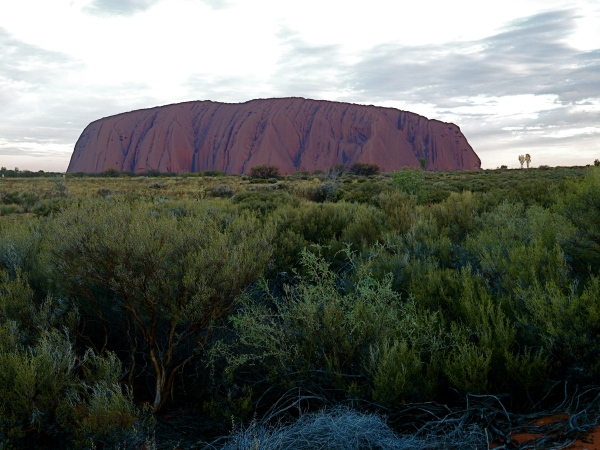 ULURU AT SUNSET -   If you walk right around the base of Uluru, you'll find it has a circumference of 9.4 kilometres. That's about 5.8 miles.