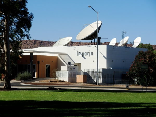 IMPARJA TE;EVISION  -   Imparja Television is an Australian television network servicing remote eastern and central Australia, that began broadcasting on 2 January 1988. It is based in Alice Springs, where it has a studio and satellite uplink facility. Notably, it is controlled by Australian Aborigines through ownership by Imparja Television Pty Ltd, and is widely regarded as a symbol of Aboriginal Australia. Most viewers receive Imparja via free to view satellite transmission, whilst a smaller proportion receive the network via analog terrestrial transmission. Imparja is an Arrernte word meaning footprints. The word is used to represent that Imparja Television aims to service Arrente people wherever they may live, from Mutitjulu to King's Canyon to Alice Springs to Tennant Creek and beyond. They describe their range as a footprint.