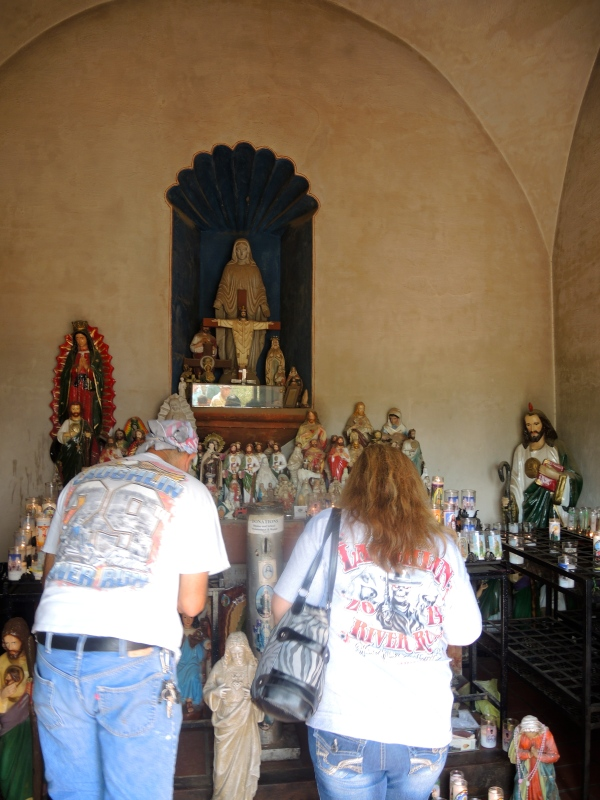 San Xavier Del Bec Mission - Parishioners lighting candles in the chapel