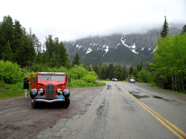 GLACIER PARK RED JAMMER ALONG THE SIDE OF THE ROAD