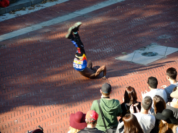 PERFORMER AT THE BETHESDA FOUNTAIN DOING A BACK FLIP