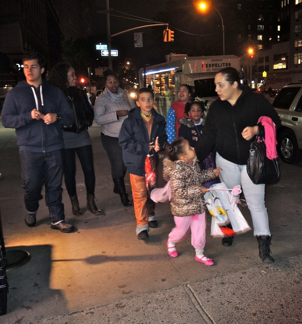 TRICK OR TREATERS ABOUT TO GO INTO A LOCAL SUPERMARKET ON BROADWAY ON THE UPPER WEST SIDE