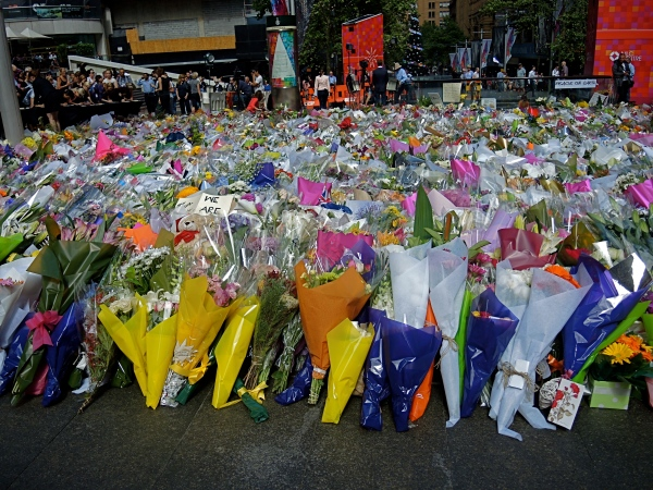 BOUQUETS OF FLOWERS LET AT MARTIN PLACE AS A TRIBUTE TO THOSE WHO DIED IN THE LINDT CAFE SHOOTOUT