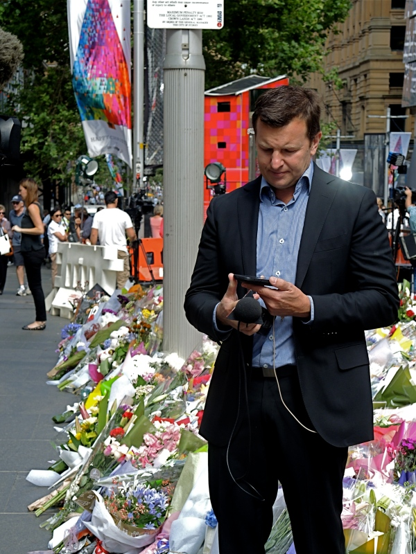 SYDNEY SIEGE: A REPORTER PREPARES TO INTERVIEW PEOPLE AT MARTIN PLACE