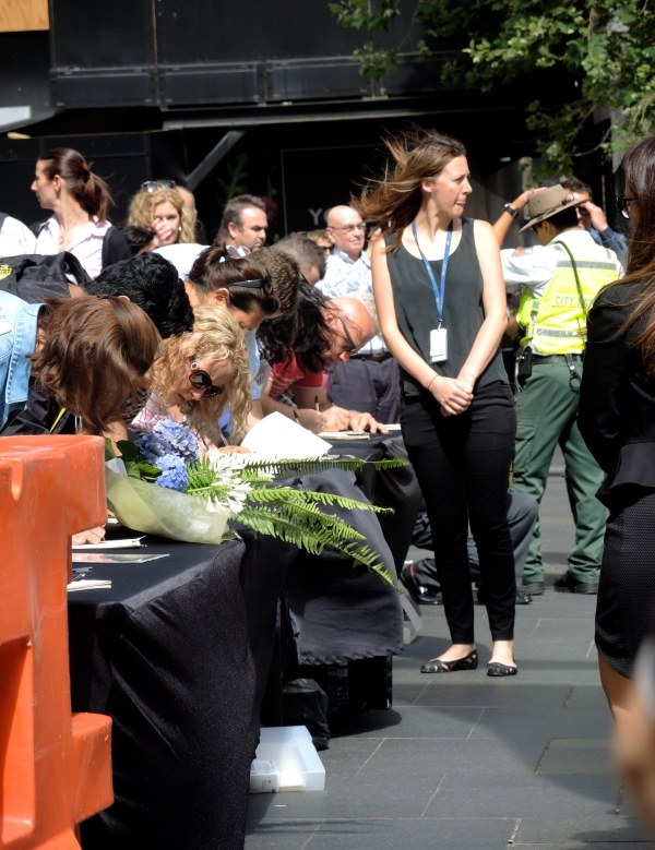 SYDNEY SIEGE: THOUSANDS CAME TO PAY THEIR RESPECT TO THOSE KILLED IN THE LINDT CAFE  SHOOT OUT AND FILL OUT CONDOLENCE BOOKS