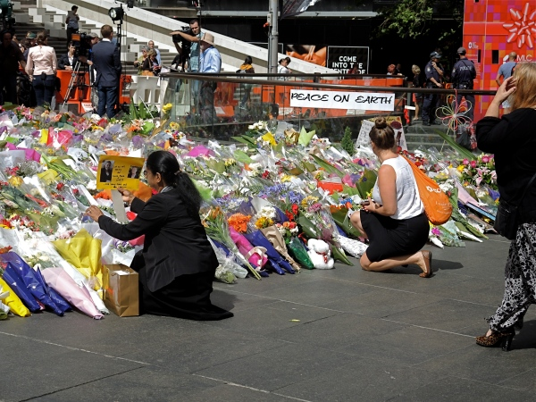THOUSANDS CAME TO PAY THEIR RESPECT TO THOSE KILLED IN THE LINDT CAFE  SHOOT OUT