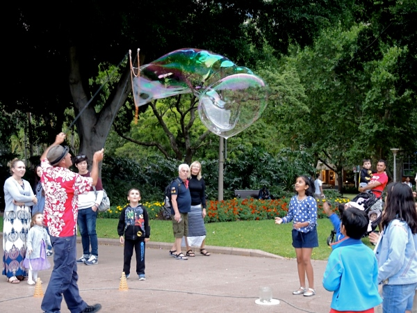 HYDE PARK  -  CHILDREN ARE AMAZED AT THE GIANT BUBBLES THE MAN HAS CREATED