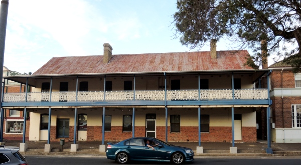 BLUEHEELER GUESTHOUSE  -  The former Blueheeler Guesthouse (now empty). Constructed in 1853 – straight after the Great Flood of 1852 - this building has over time traded at the Crown Inn, Tracey's Club House Hotel and the Gresham Hotel. Note the rather intricate verandah.