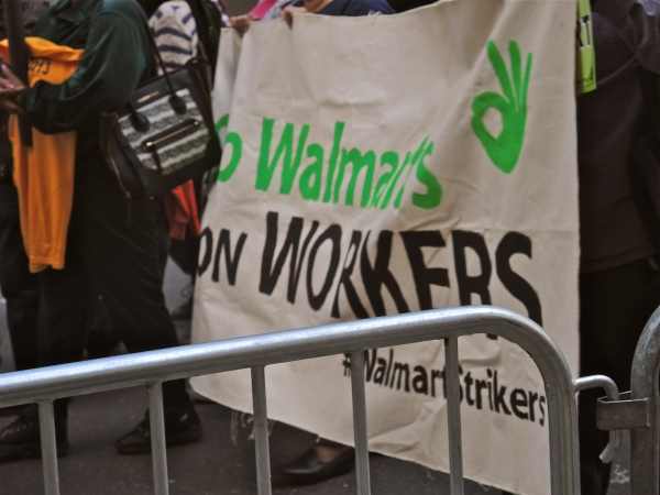 walmart sign  -  PROTESTORS FOR A $15 AN HOUR MINIMUM WAGE MARCHING DOWN BROADWAY APRIL 15  2015