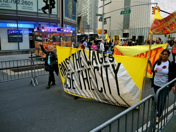 PROTESTORS FOR A $15 AN HOUR MINIMUM WAGE MARCHING DOWN BROADWAY APRIL 15  2015