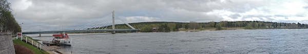 PANORAMA of Jätkänkynttilä bridge with its eternal flame over the Kemijoki river,