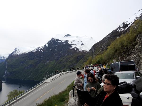 TOURISTS TAKE PHOTOS OF GEIRANGER