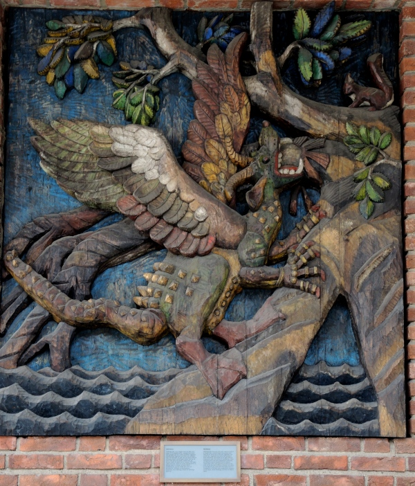 PAINTED, CARVED WOOD PANELS ON EXTERIOR OF THE TOWN HALL